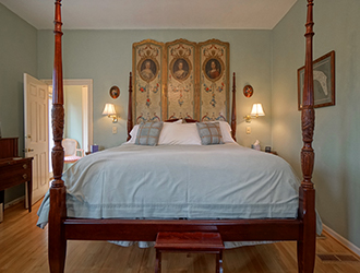 The four poster bed is slightly elevated. Live like royalty!
