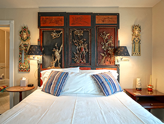 The Queen bed in the Sake has a beautiful Japanese style headboard.