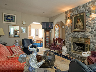 Our lounge has eclectic artwork and stately stone fireplace.