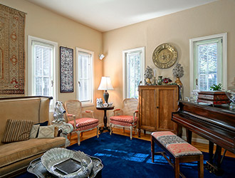 Our lounge includes a relaxing sofa and a piano.